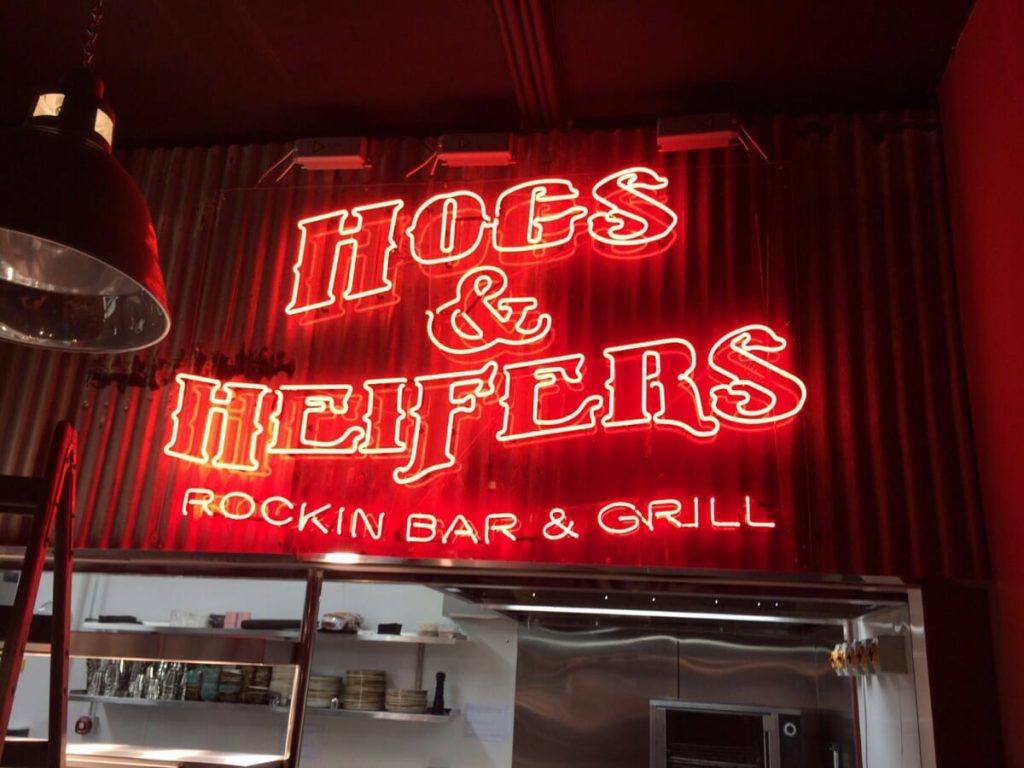 hogs and heifers neon