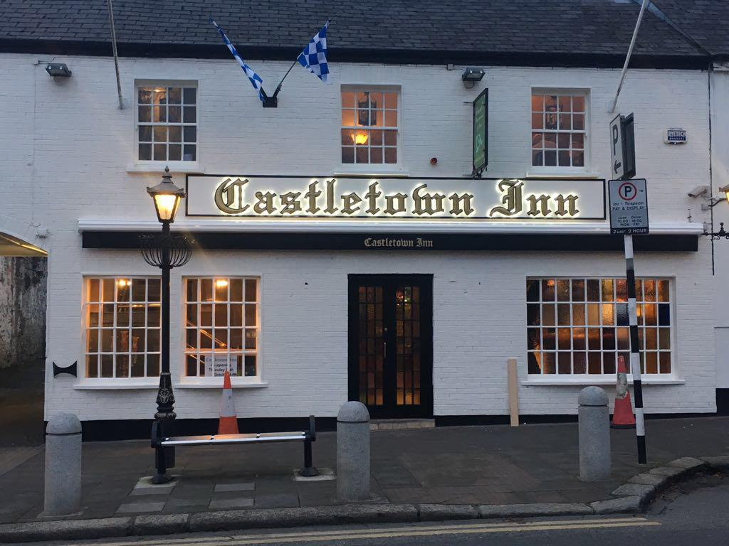 Castletown inn pub with glowing sign made by Elite Branding