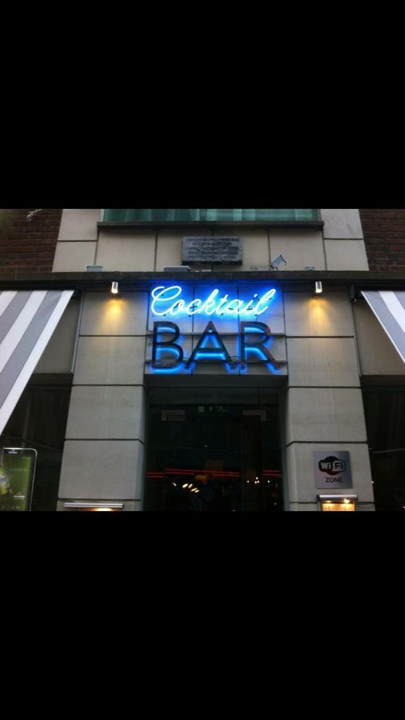 Light up neon sign for Cocktail Bar Dublin glowing blue elite branding ireland