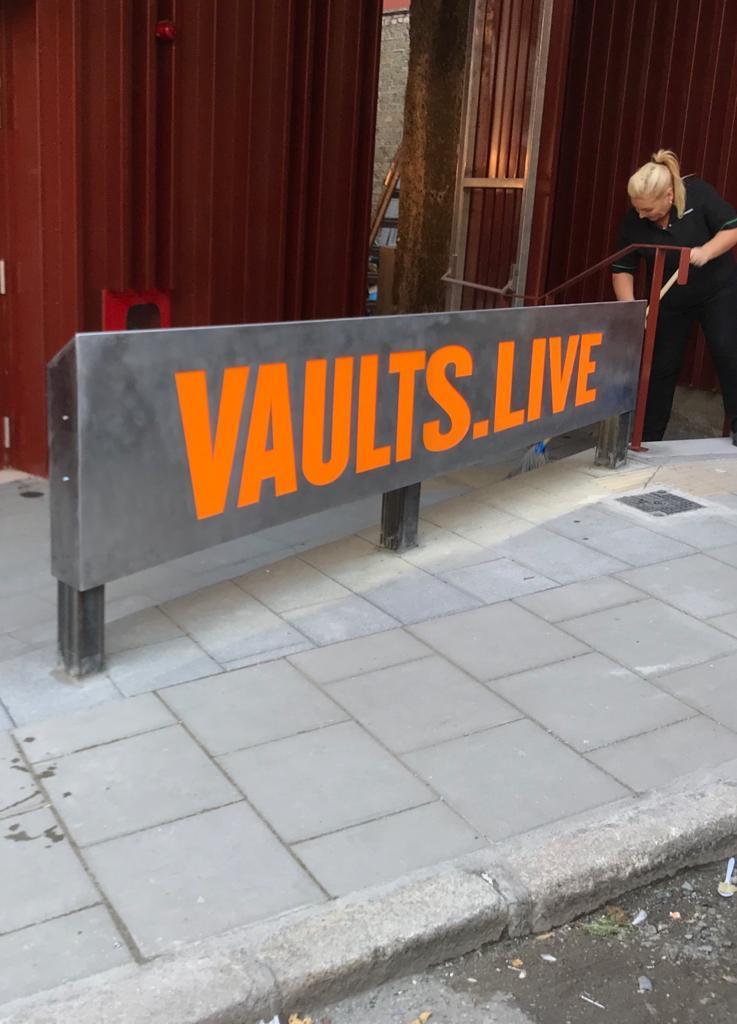 The Vaults Signage Dublin Elite Branding Stainless Steel and Orange lettering
