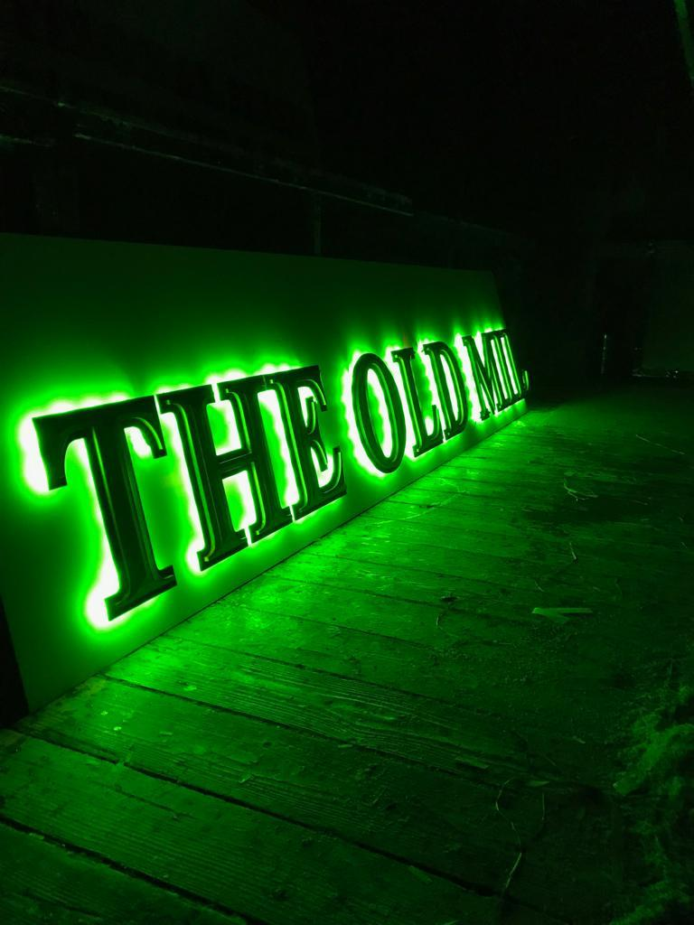 The Old Mill glowing green sign neon Elite Branding