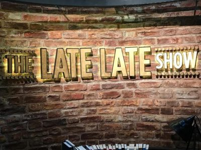 The late late show signage made by Elite Branding - Glowing gold letters on a brick wall for the set of the rte show.
